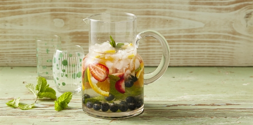 Water jug filled with water and fruit