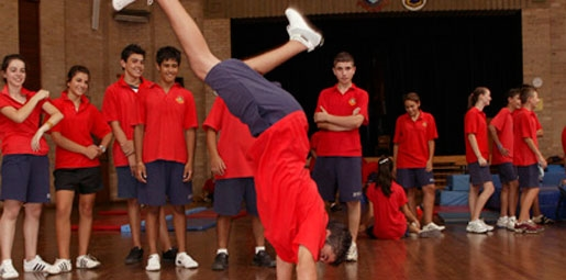 school kid doing a handstand