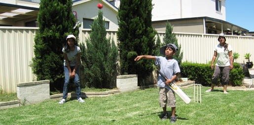 Superieur In Your Backyard. Children Playing Backyeard Cricket