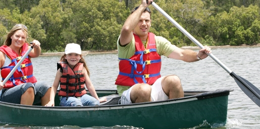 Two adults and child in a canoe