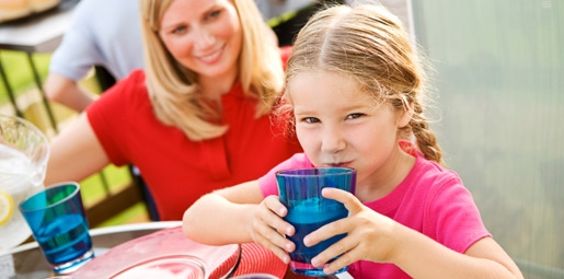 girl drinking cup of water