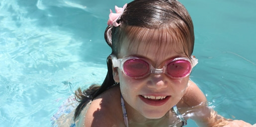 girl smiling in pool