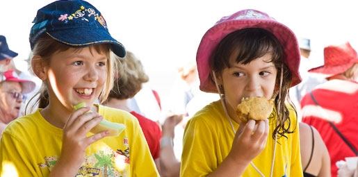 Kids eating honey dew melon and healthy muffin snacks