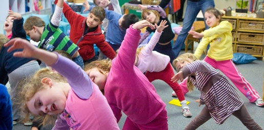 Young children dancing at childcare