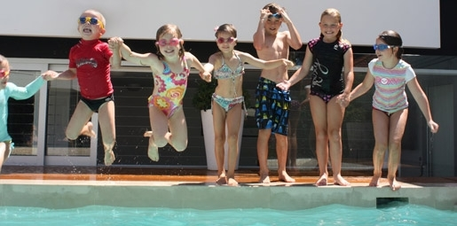 kids jumping in pool