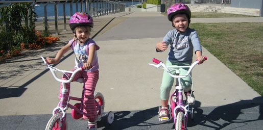 little girls on bikes