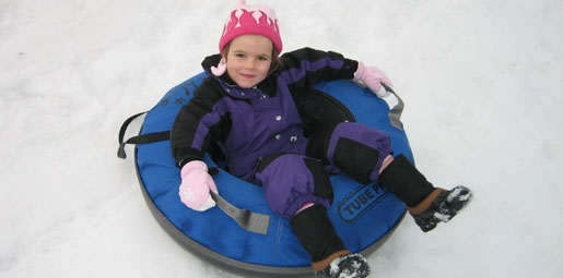girls in snow tube