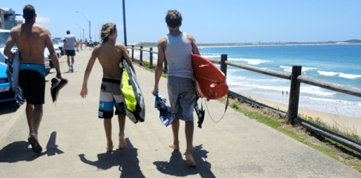 surf boys walking with Dad