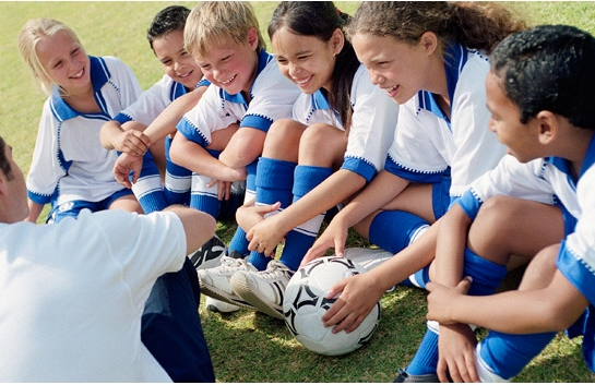Soccer players listening to coach